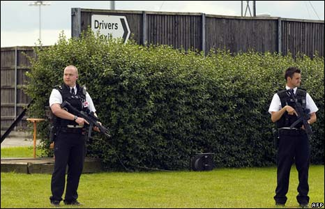 Armed British police stand guard as President Bush arrives