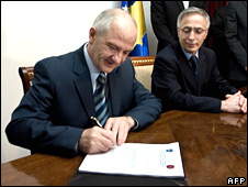 Kosovo's President Fatmir Sejdiu (left) and parliament speaker Jakup Krasniqi sign Kosovo's constitution in Pristina on 15 June
