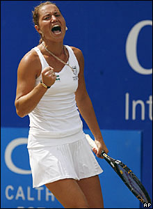 Kateryna Bondarenko celebrates taking the first set against Yanina Wickmayer in Birmingham