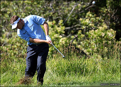 Lee Westwood plays from the rough after dropping at the 13th