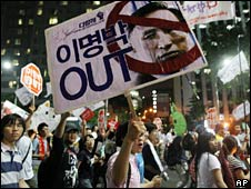 Protesters march through the streets of Seoul on 13 June 2008