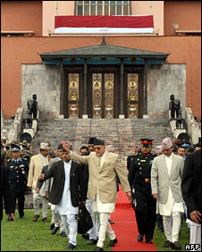 Nepalese Prime Minister Girija Prasad Koirala (C) arrives for the inaugural flag-hoisting ceremony at the Narayanhiti Palace, which has now been declared a museum, in Kathmandu, 15 June 2008