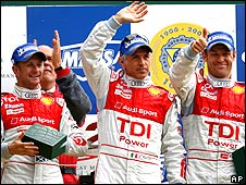 Allan McNish (left), Rinaldo Capello and Tom Kristensen celebrate on the Le Mans podium