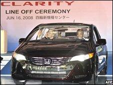 Honda's president Takeo Fukui (R) in the FCX Clarity