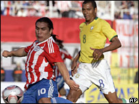 Salvador Cabanas of Paraguay gets past Brazil's Gilberto Silva