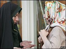 Iranian policewoman stops woman to challenge her on her dress - file picture 2007