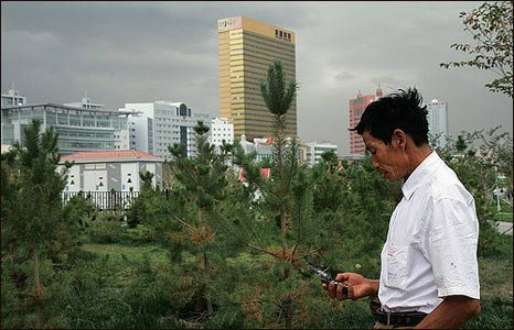 A man uses a mobile phone in Urumqi, China (Photo: Pawel Boguslawski)