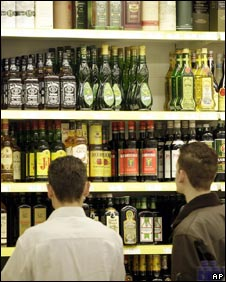 Young men looking at alcohol on a shop shelf