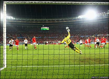 Ballack's free-kick heads for the net