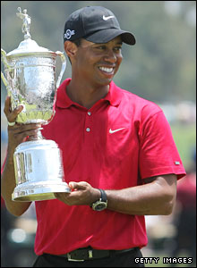 Tiger Woods with the trophy