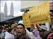 Malaysians protest against the rising price of fuel in Kuala Lumpur on 6 June