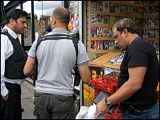Police and trading standards officers at a stall