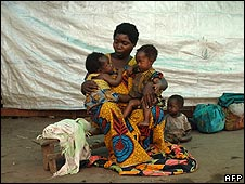 Mother with her children in a camp for displaced people in Kinyandonyi, DR Congo
