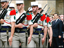 Nicolas Sarkozy inspects a military parade