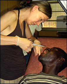 Claire treating a patient