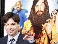 Mike Myers with the poster of Love Guru in the background