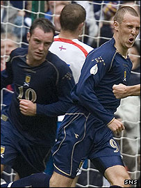 Kris Boyd and Kenny Miller in action for Scotland