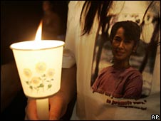 A woman wearing a T-shirt supporting Aung San Suu Kyi at a candle-light vigil