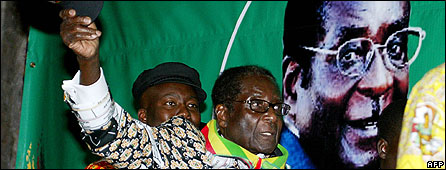 "Zimbabwe""s President Robert Mugabe attends a youth convention in the capital Harare on June 13, 2008"