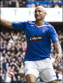 Daniel Cousin celebrates a goal at Ibrox