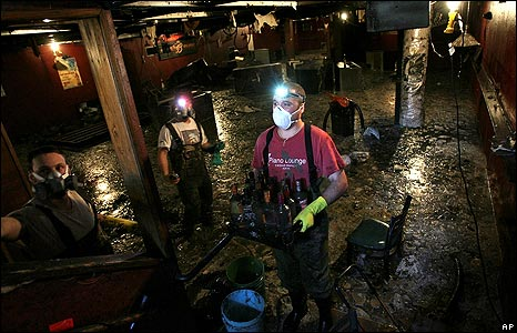 Employees and friends of the Cedar Rapids Piano Lounge help to remove debris