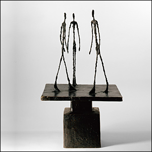 Trois hommes qui marchent I by Giacometti