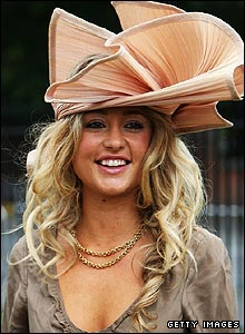 A racegoer arrives at Ascot for day two of the Royal Meeting