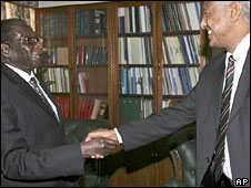 Mr Mugabe shakes hands with UN envoy Haile Menkerios (right)