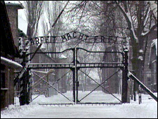 The entry gate to Auschwitz concentration camp, with the words 'Arbeit Macht Frei' (work liberates) overhead