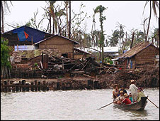 Damaged buildings in a Burmese village
