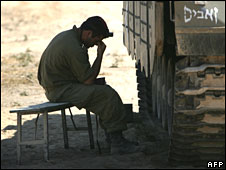 An Israeli soldier prays next to his tank along the border with Gaza Strip on 18 June 2008