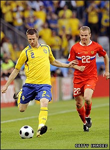Swedish defender Mikael Nilsson tussles with Russia's Alexander Anyukov