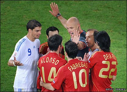 Referee Howard Webb has his hands full at the end of the opening half