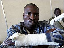Movement for Democratic Change members allegedly beaten by Mugabe supporters with sticks, May 2008