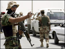 An Iraqi soldier directs traffic in southern Iraq, 16 June 2008