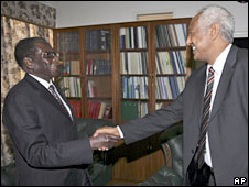 UN official Halie Menkerios, right, greets Robert Mugabe in Harare, 17 June 2008