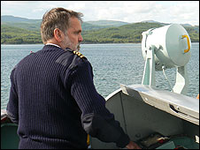 Captain John Webb steers a ferry out of Kennacraig