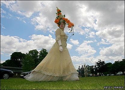 Model Laura Meakin arrives wearing a bespoke hat by designer Louis Mariette during Ladies Day