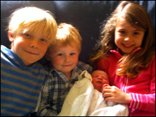 Daniel, Rhodri, and Katie Phillips and baby Megan