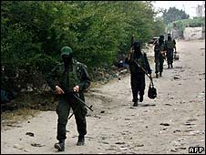 Hamas militants return from firing positions close to Israel on 19 June
