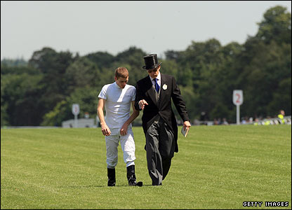 Jockey Johnny Murtagh walks the course with trainer Aidan O' Brien