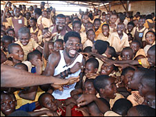 Emmanuel Adebayor with children at his former school