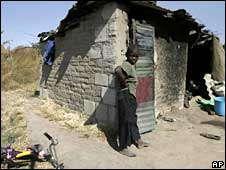 Poor boy in shack near Harare