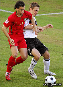 Portugal's Simao is challenged by Philipp Lahm