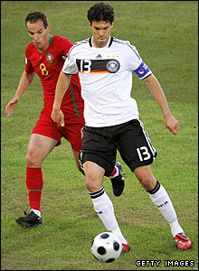 Petit attempts to close down German midfielder Michael Ballack
