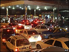 Cars queue outside a petrol station in Chengdu