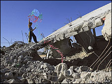 Boy flies kite in Rafah, Gaza