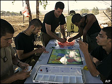 Israeli stationed near Gaza play board games