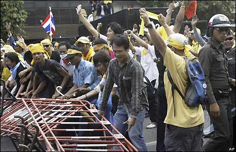 Anti-government protesters pull down police barricade in Bangkok, Thailand