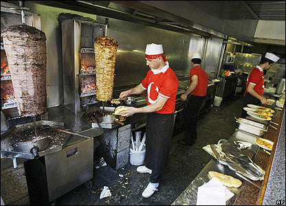 Turkish kebab shop staff proudly wear their team's colours in the Austrian capital
